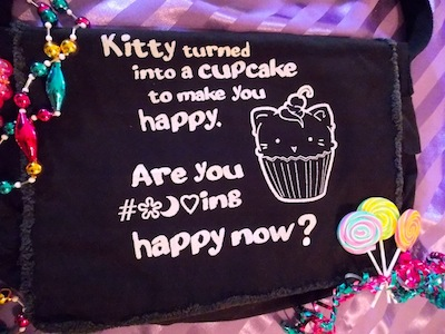 Cupcake Kitty asks, Are you happy now?